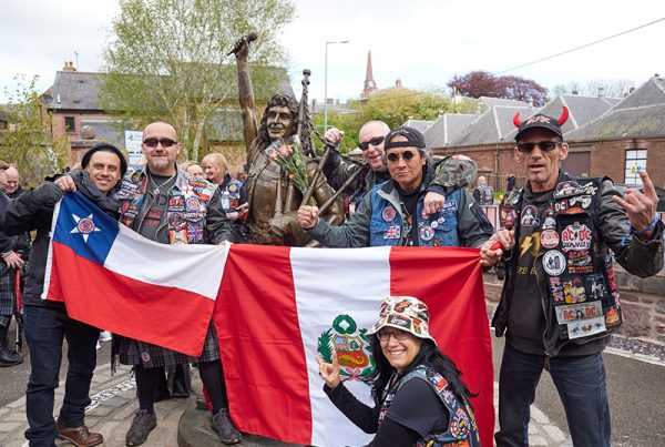 festival attendees at Bon Scott statue