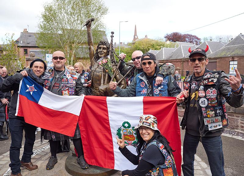 festival attendees at Bon Scott statue